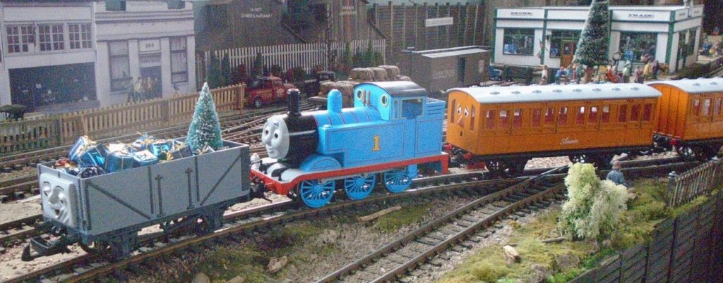 Thomas the Tank Engine has persuaded one of the Troublesome Trucks to carry the presents belonging to the passengers in Annie and Clarabel