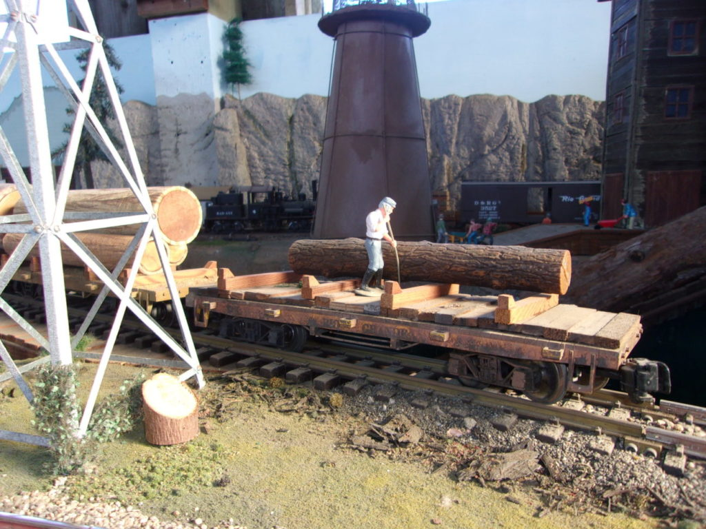 Helping the last log into the mill pond
