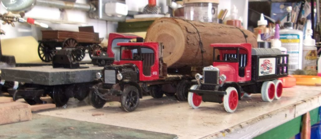 Federal truck with massive log and a smaller federal truck awaiting kitbashing